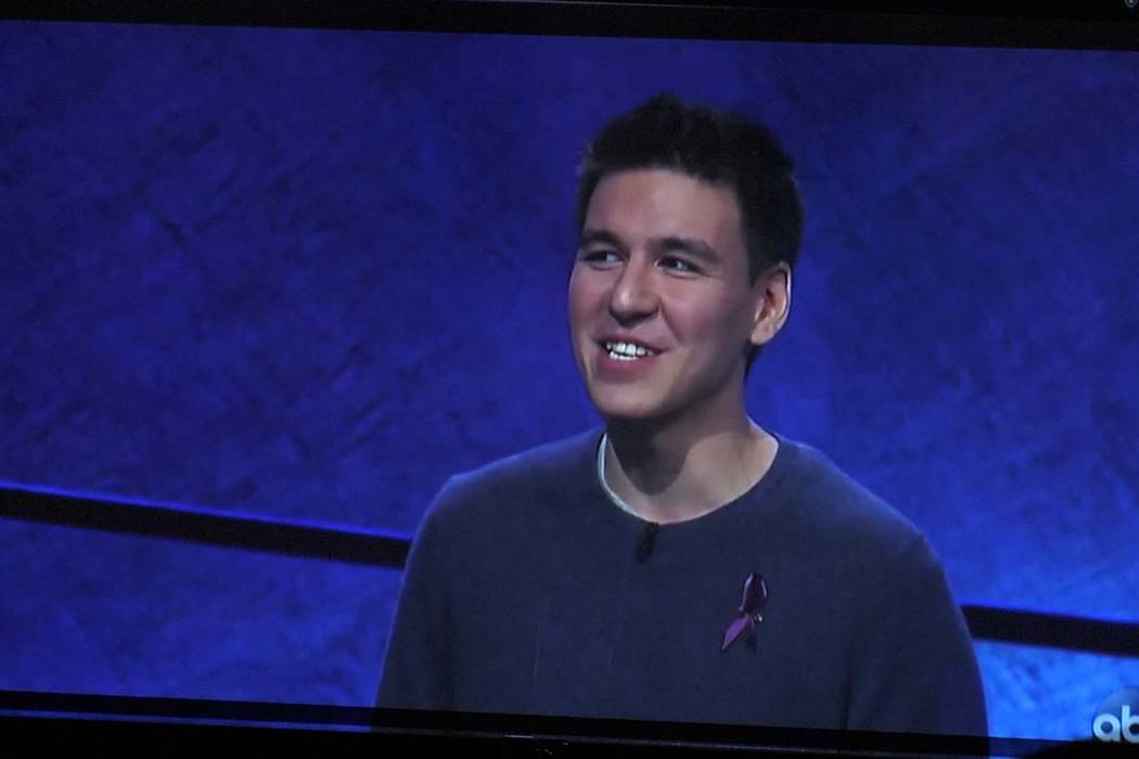 """James Holzhauer appears on a TV sceen during a watch party for the """"Jeopardy!The&# ..."""