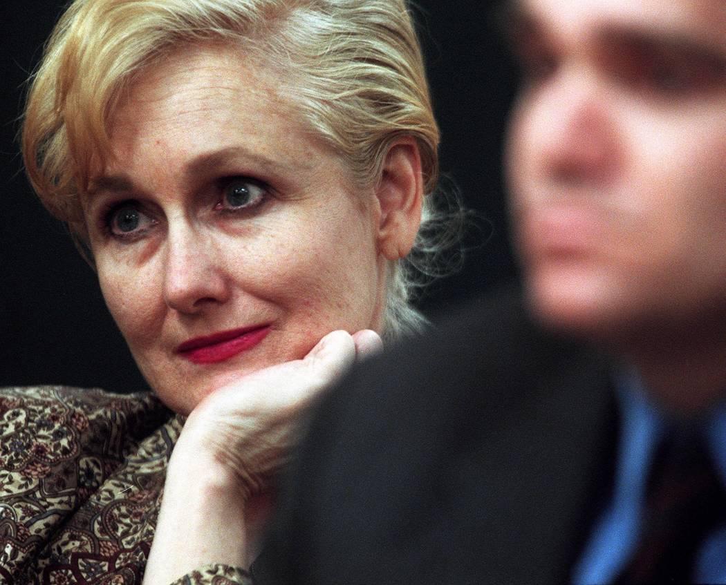 Margaret Rudin and her attorney Jordan Savage listen while Judge Joseph Bonaventure rules that ...