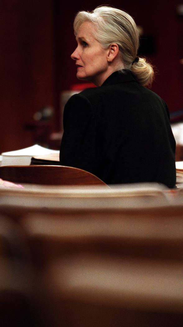 Margaret Rudin sits in an empty courtroom waiting for her attorneys to arrive in this undated p ...