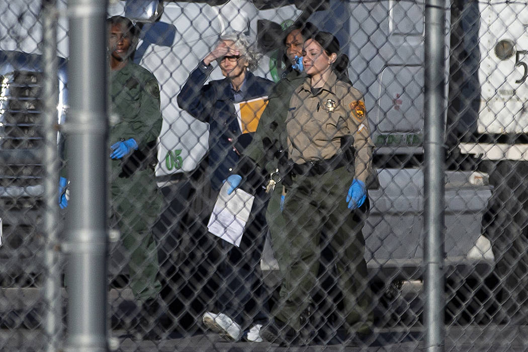 Margaret Rudin, second from left, is escorted out of Florence McClure Women's Correctional Cent ...