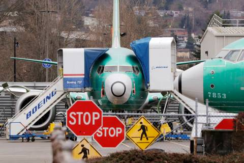 In this Monday, Dec. 16, 2019, file photo, a Boeing 737 Max jets sit parked in Renton, Wash. Ne ...