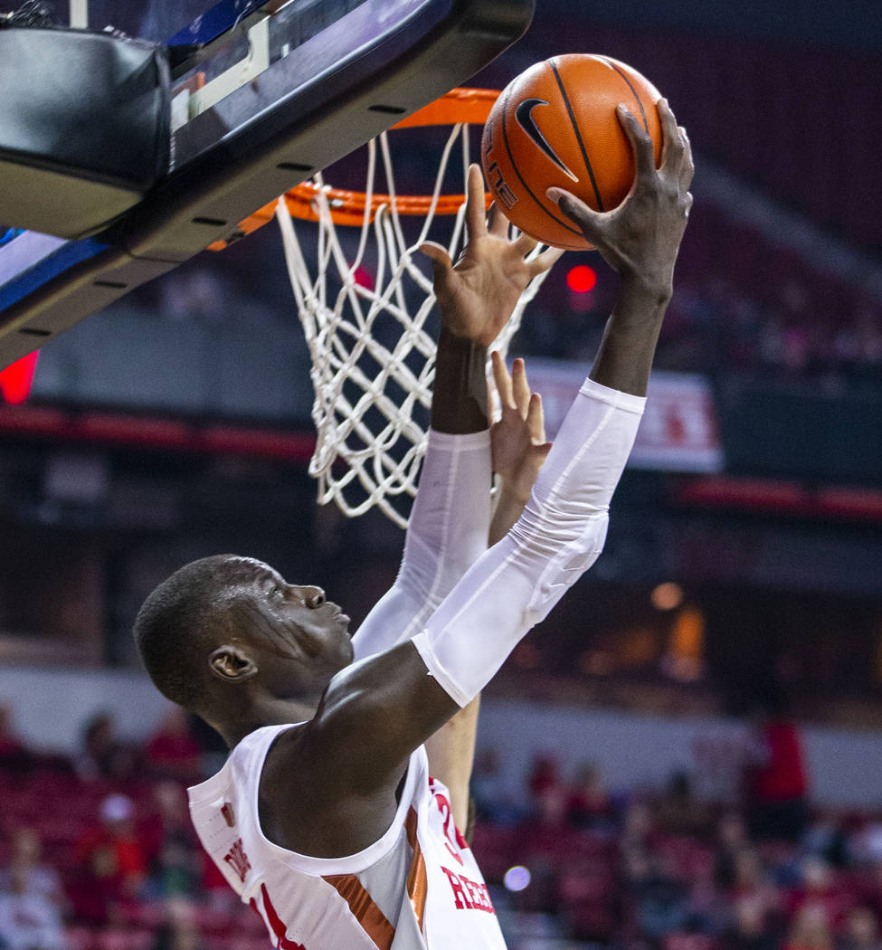 UNLV Rebels forward Mbacke Diong (34) gets off a shot under the rim over Air Force Falcons defe ...