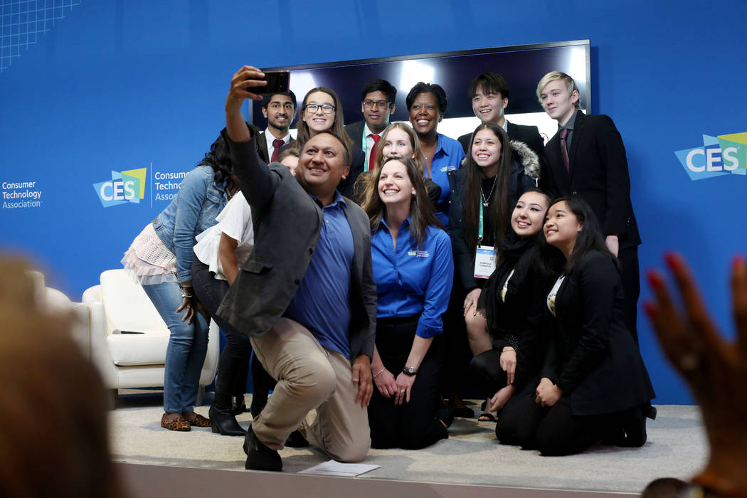Moderator Snehal Bhakta with Clark County School District takes a photograph with the judges an ...