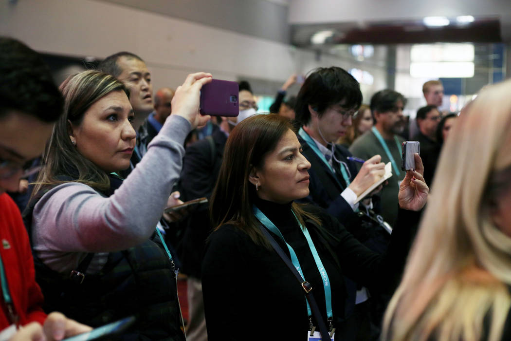 A crowd gathers to watch Las Vegas high school students presents app ideas during the Student B ...