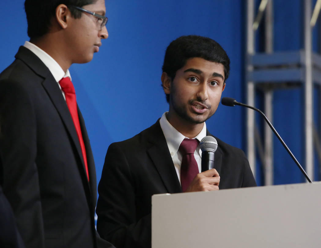 Southwest Career and Technical Academy students Ishaan Raja, left, and Anish Chejerla present t ...