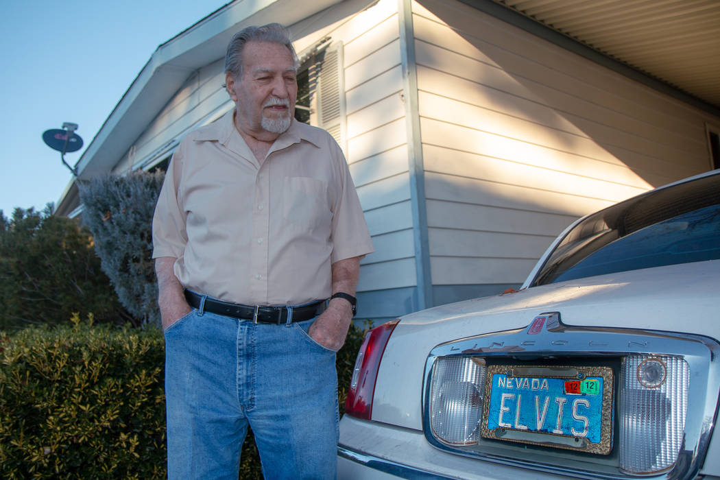 """James Mesinger, and 82-year-old, stands next to his Lincoln Town Car with its vanity """"Elvis"""" li ..."""