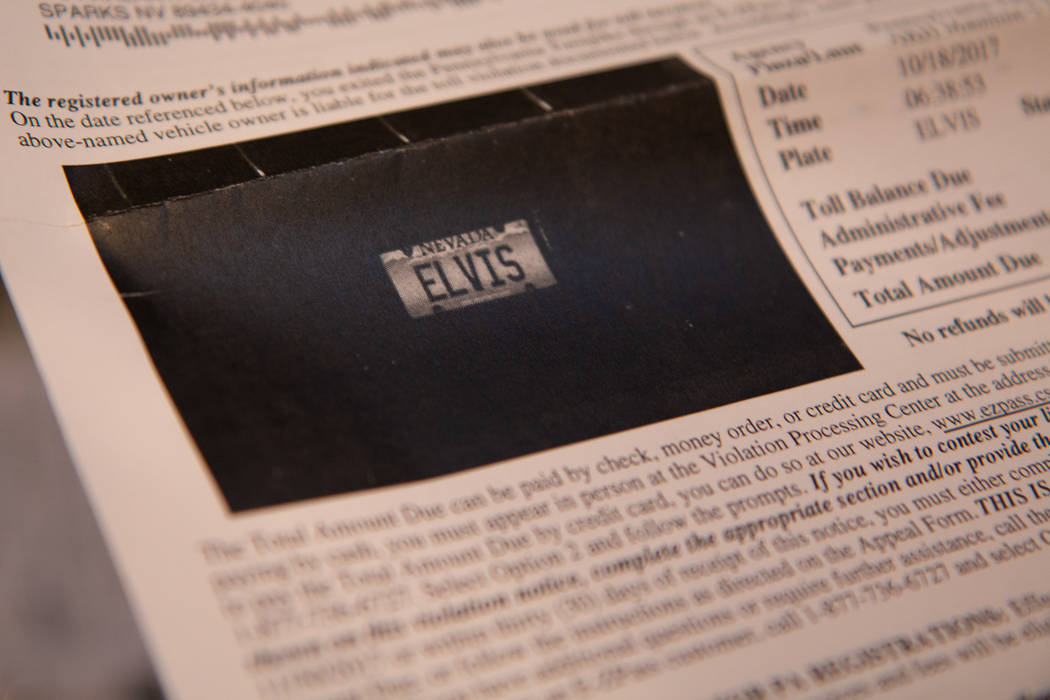 James Messinger, 82, holds one of the numerous fines that he received after vehicles donning no ...