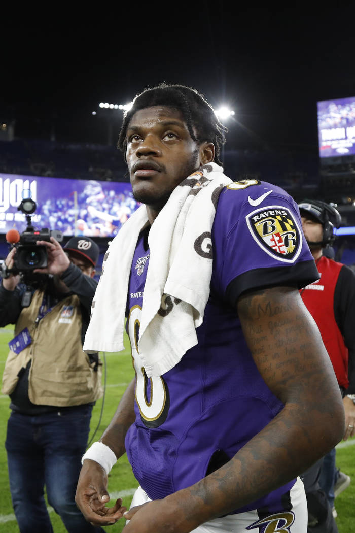 Baltimore Ravens quarterback Lamar Jackson leaves the field after an NFL divisional playoff foo ...