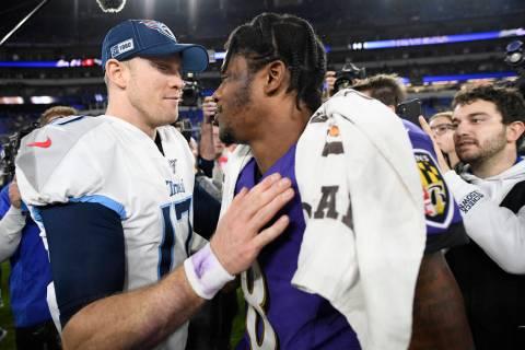 Tennessee Titans quarterback Ryan Tannehill, left, speaks with Baltimore Ravens quarterback Lam ...