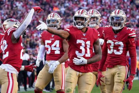 San Francisco 49ers' Raheem Mostert (31) celebrates with teammates after recovering a fumble ag ...