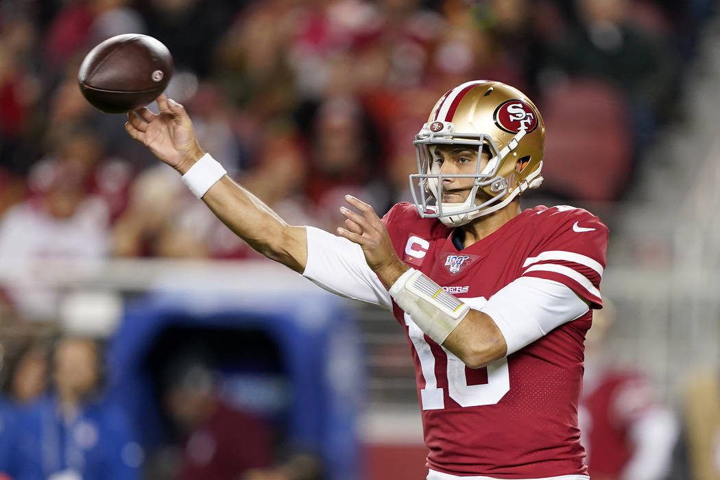 San Francisco 49ers quarterback Jimmy Garoppolo releases a pass against the Los Angeles Rams du ...