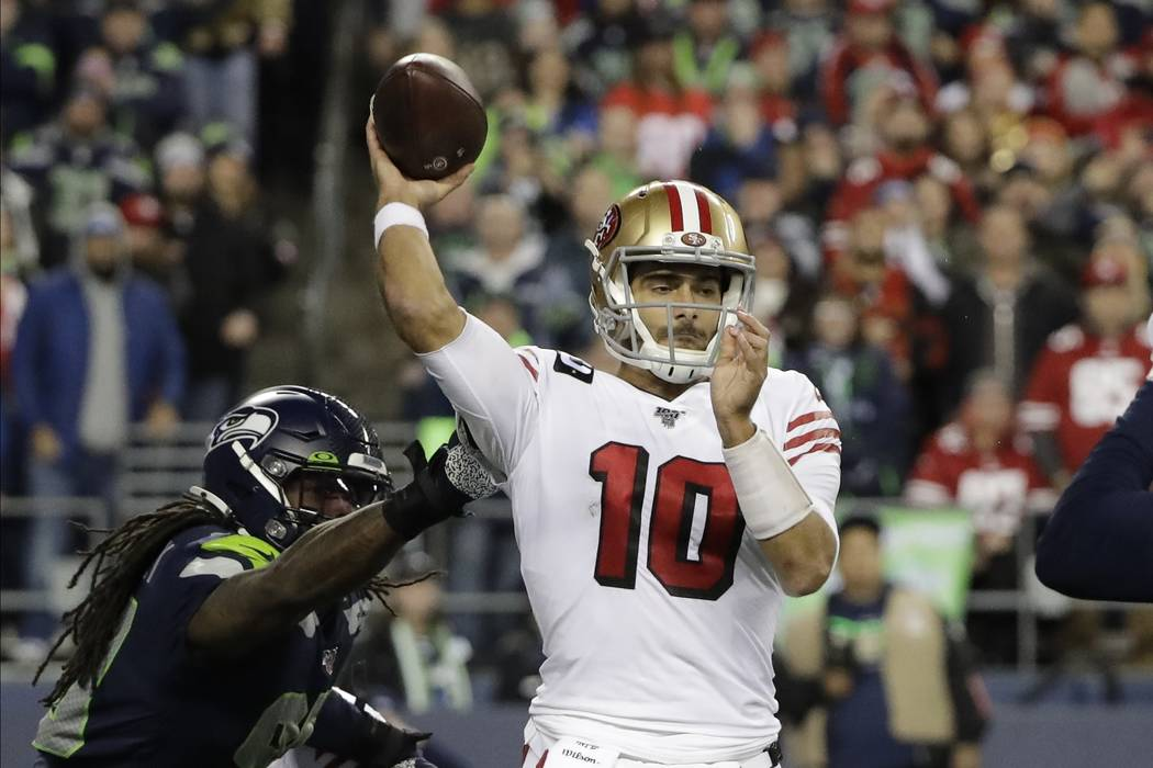 San Francisco 49ers quarterback Jimmy Garoppolo in action against the Seattle Seahawks during t ...