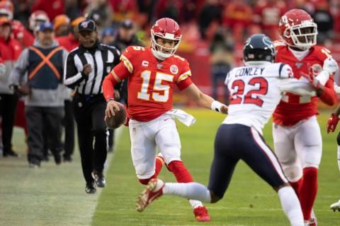 Kansas City Chiefs quarterback Patrick Mahomes scrambles for a first down during an NFL divisio ...