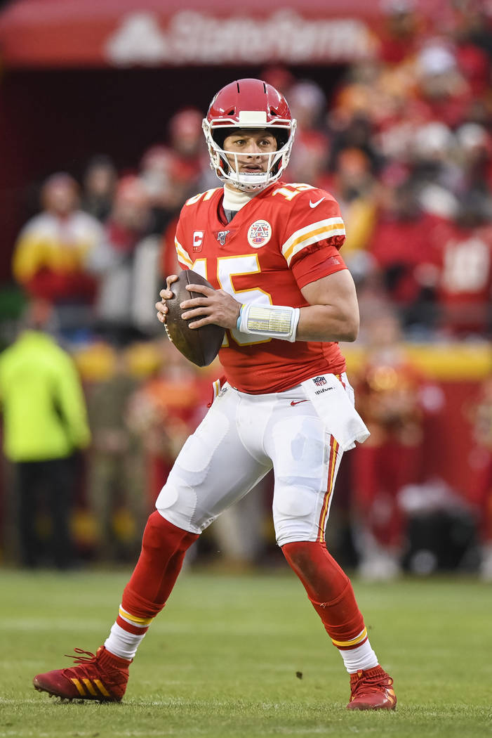 Kansas City Chiefs quarterback Patrick Mahomes (15) looks to throw against the Houston Texans d ...