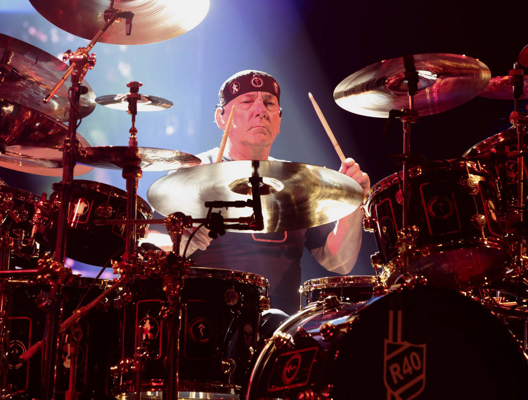 Neil Peart of the band Rush performing in concert during their R40 Live: 40th Anniversary Tour ...