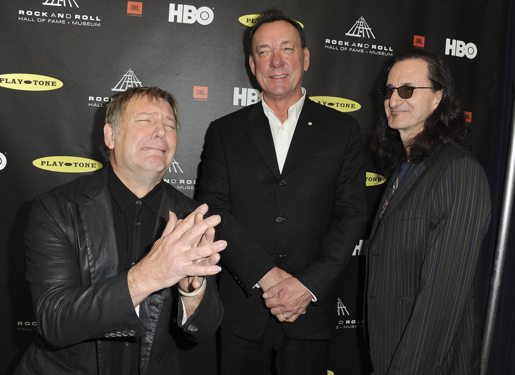 Alex Lifeson, left, Neil Peart and Geddy Lee of Rush at the Rock and Roll Hall of Fame Inductio ...