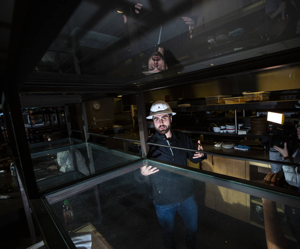 Golden Knights' Alex Tuch talks during a tour of the current Wolfgang Puck Bar & Grill spac ...