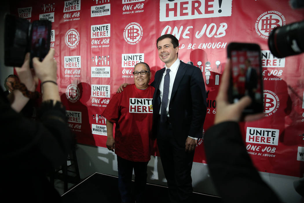 Democratic presidential candidate Pete Buttigieg, right, takes a photograph with union member M ...