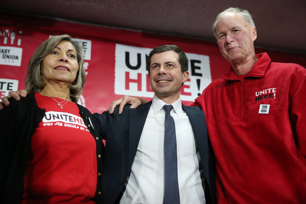 Democratic presidential candidate Pete Buttigieg, center, with Geoconda Arguello-Kline, left, s ...