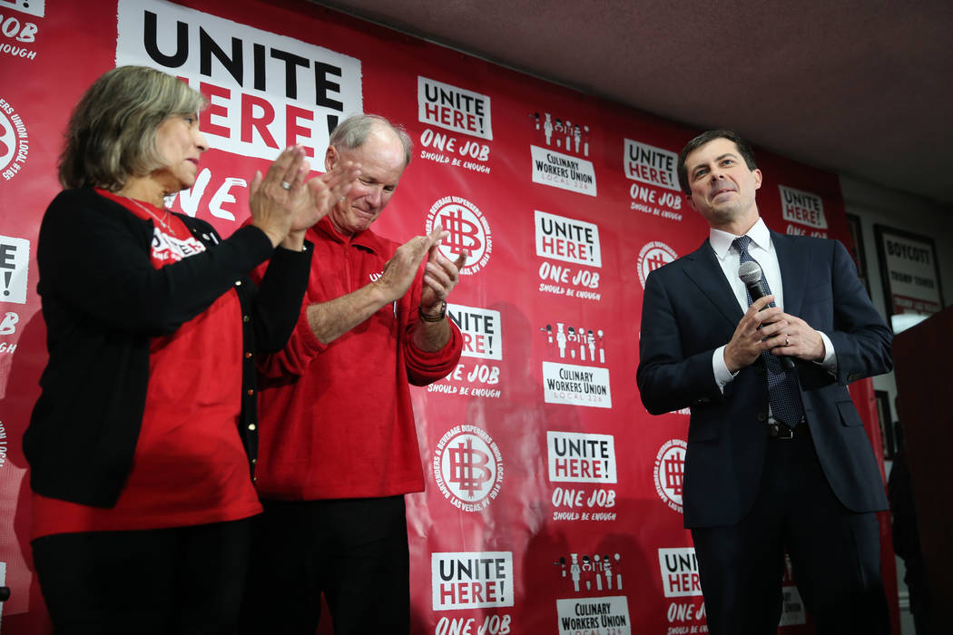 Democratic presidential candidate Pete Buttigieg, far right, is welcomed to the stage by Geocon ...