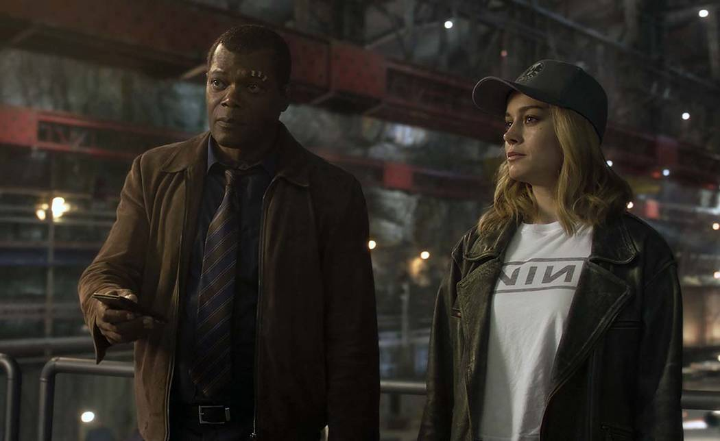 This image released by Disney-Marvel shows Samuel L. Jackson as a younger Nick Fury, left, and ...