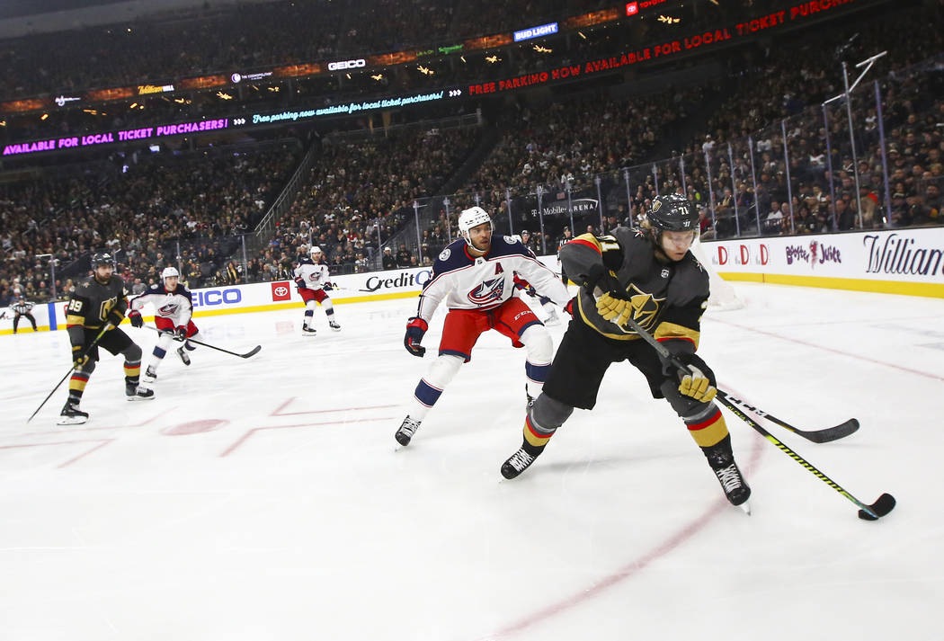 Golden Knights' William Karlsson (71) skates with the puck in front of Columbus Blue Jackets' S ...