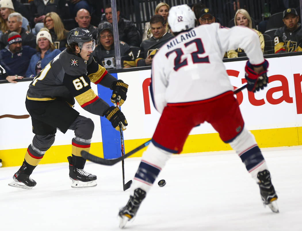 Golden Knights' Mark Stone (61) skates with the puck in front of Columbus Blue Jackets' Sonny M ...