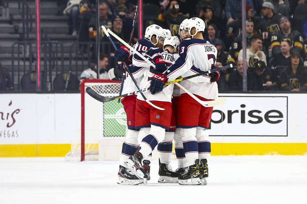 The Columbus Blue Jackets celebrate a goal against the Golden Knights during the first period o ...