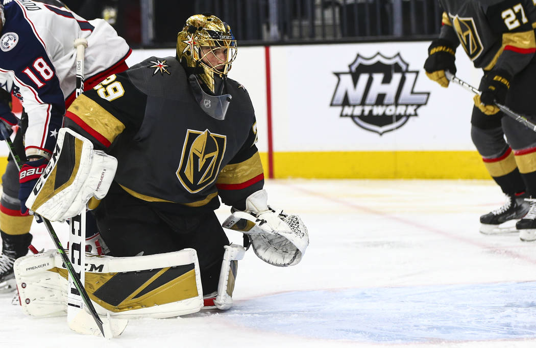 Golden Knights goaltender Marc-Andre Fleury (29) looks at the net after getting scored on by th ...