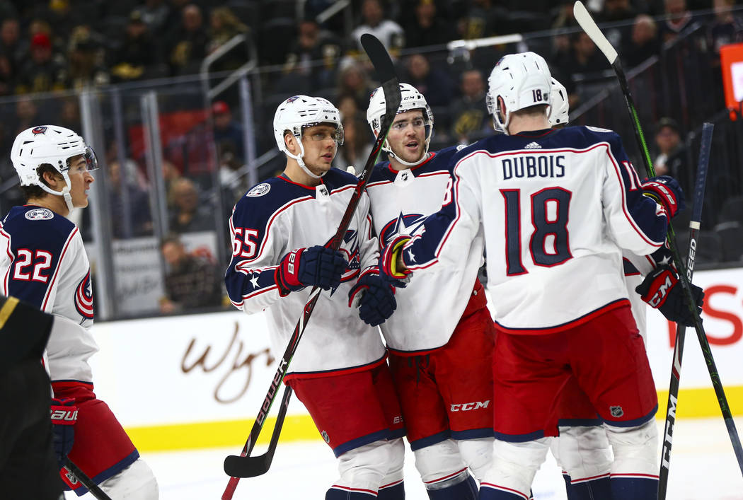 The Columbus Blue Jackets celebrate their second goal of the game against the Golden Knights du ...