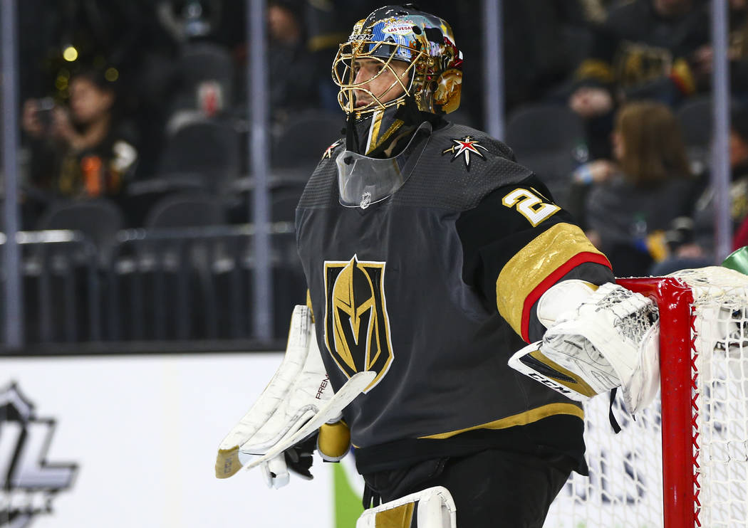Golden Knights goaltender Marc-Andre Fleury (29) looks on before the start of the second period ...