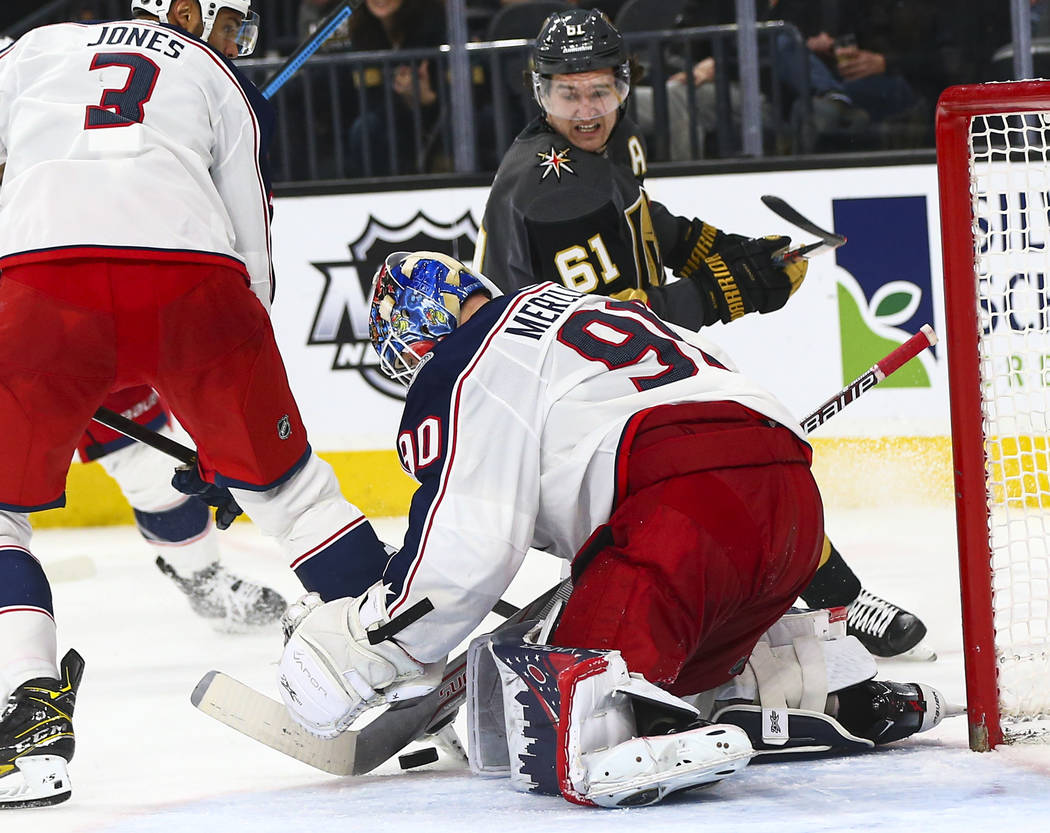 Columbus Blue Jackets goaltender Elvis Merzlikins (90) looks to stop the puck in front of Golde ...
