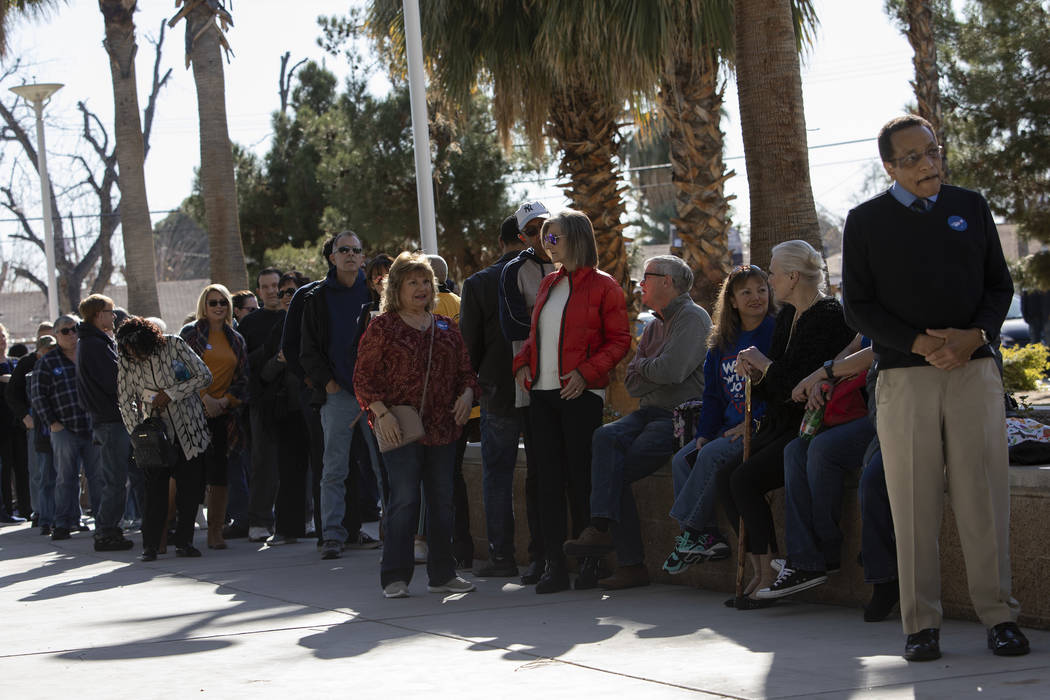 People wait in line to hear Joe Biden speak at a campaign event at Rancho High School on Saturd ...