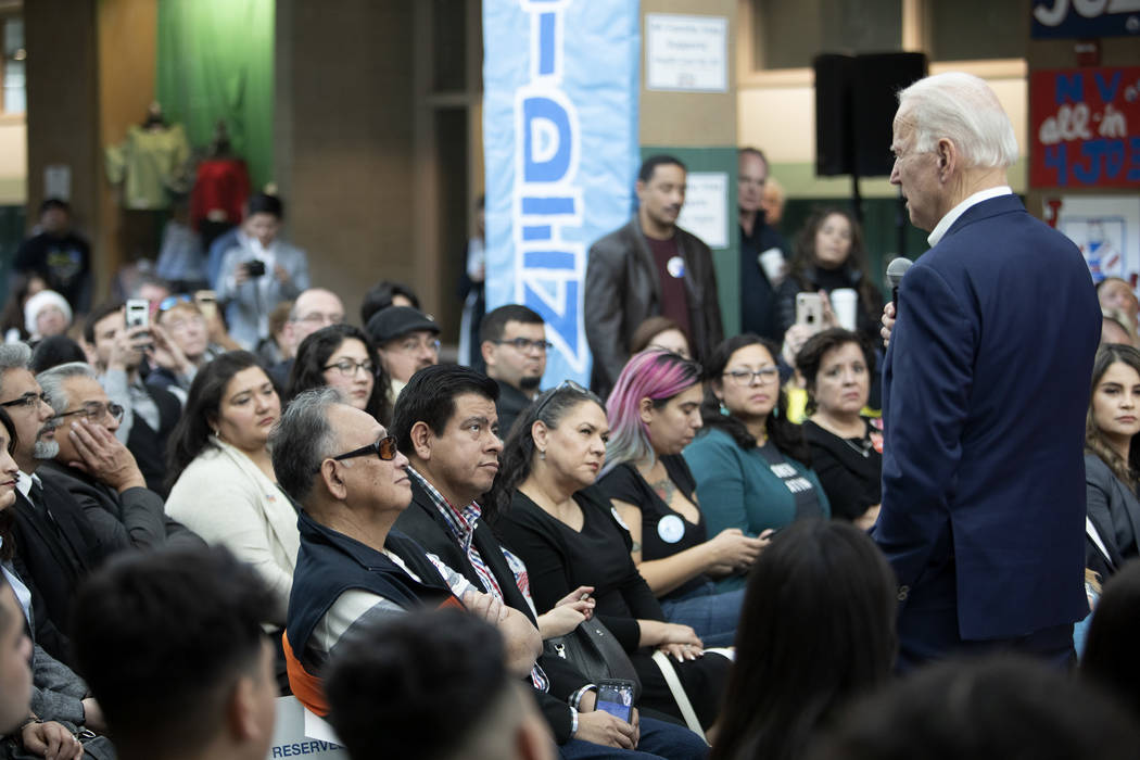 The audience listens as presidential candidate Joe Biden delivers his message at a campaign eve ...