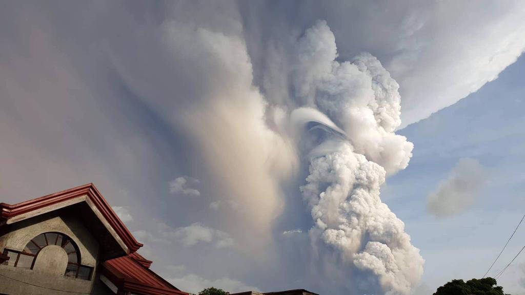 Taal Volcano spews ash and smoke during an eruption as seen from Cavite province, south of Mani ...