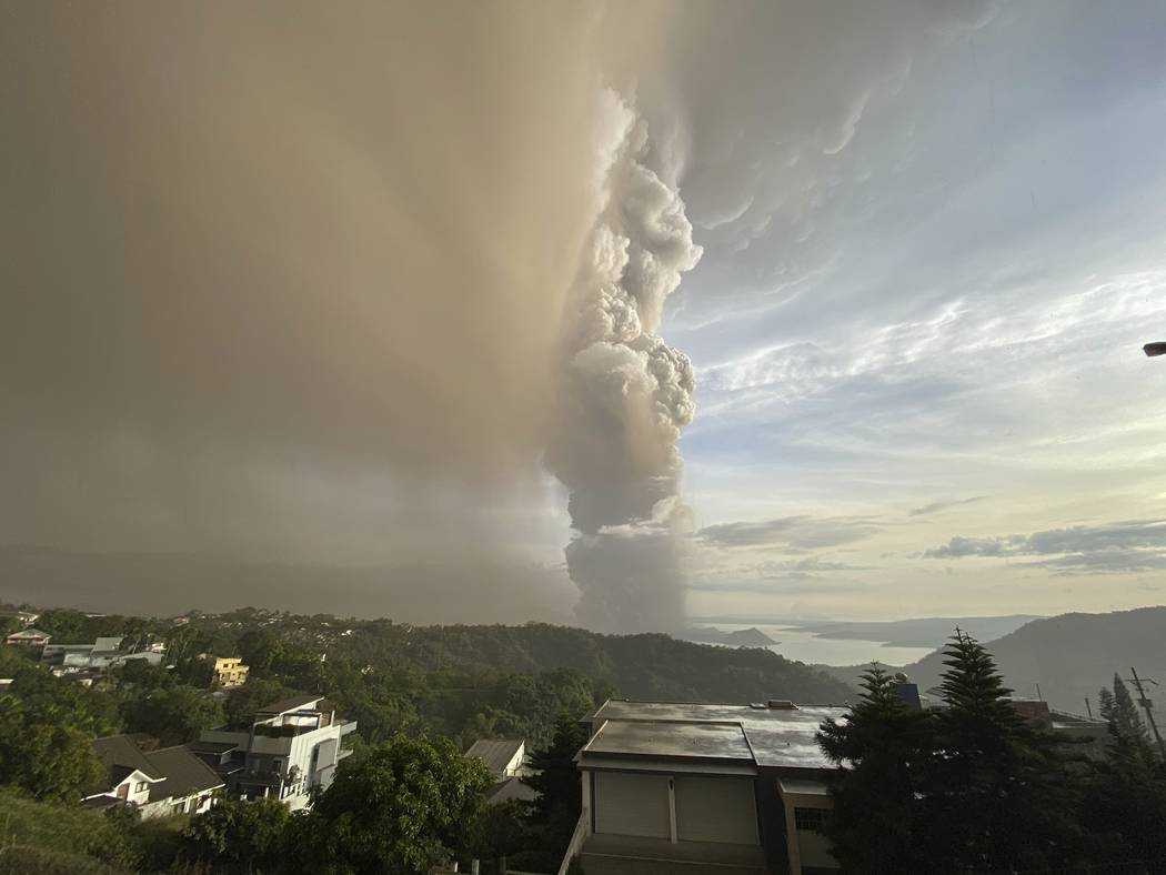 Plumes of smoke and ash rise from as Taal Volcano erupts Sunday Jan. 12, 2020, in Tagaytay, Cav ...