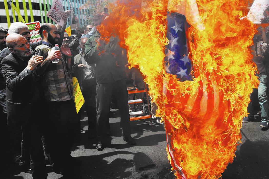 Iranian protestors burn a representation of a U.S. flag. (AP Photo/Vahid Salemi)