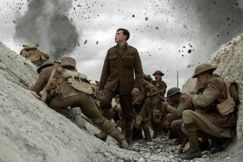 "This image released by Universal Pictures shows George MacKay, center, in a scene from ""19 ..."