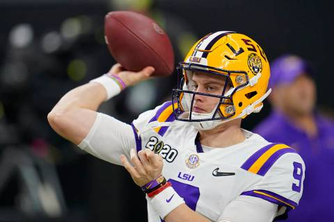 LSU quarterback Joe Burrow warms up before a NCAA College Football Playoff national championshi ...