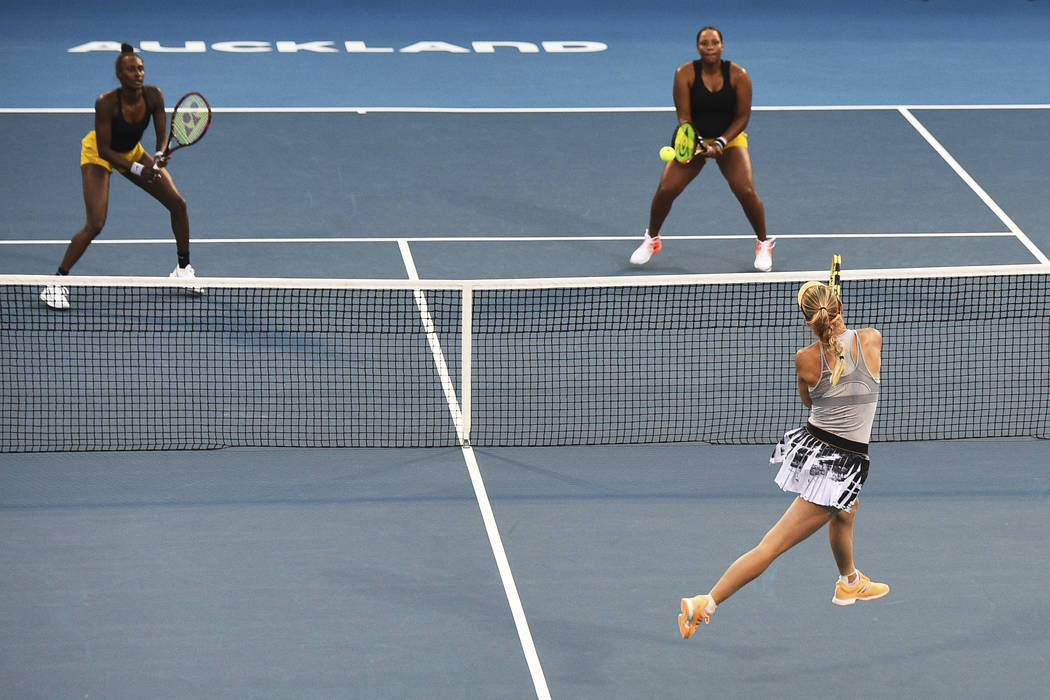 Denmark's Caroline Wozniacki plays a shoot during the finals doubles match United States Serena ...