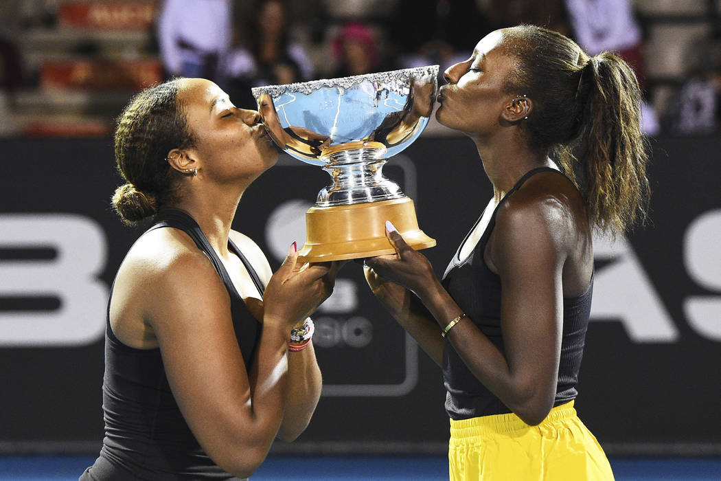 Taylor Townsend, left, from the United States and United States player Asia Muhammad with the A ...