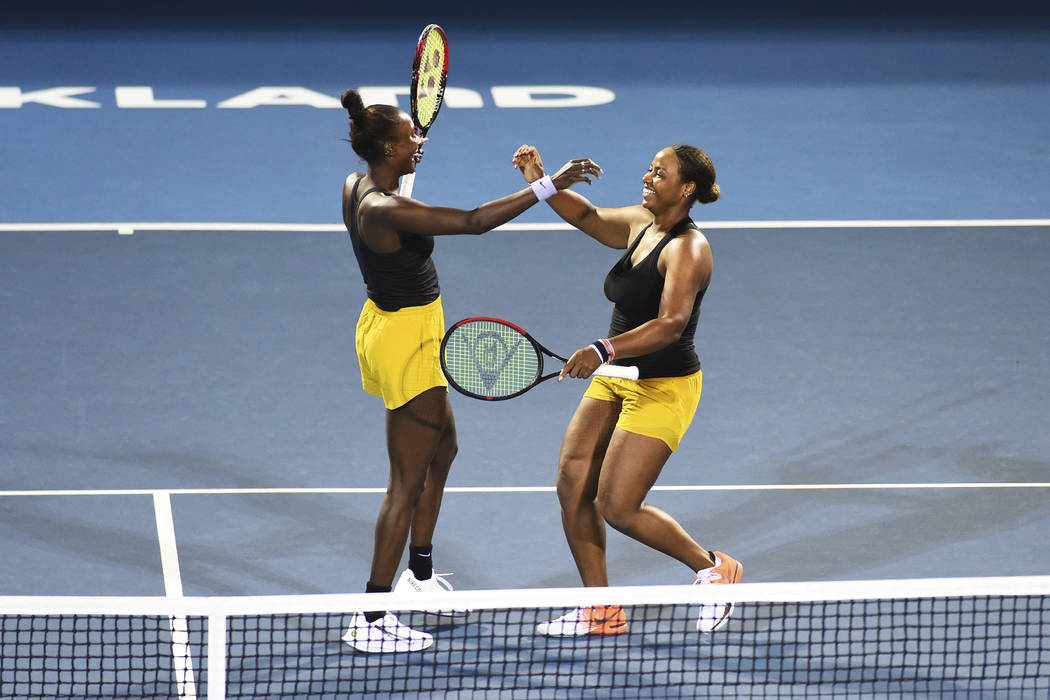 United States player Asia Muhammad, left, and Taylor Townsend from the United States celebrates ...