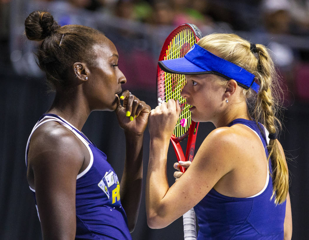 The Vegas Rollers' Asia Muhammad, left, and Harriet Dart confer between serves during their mix ...