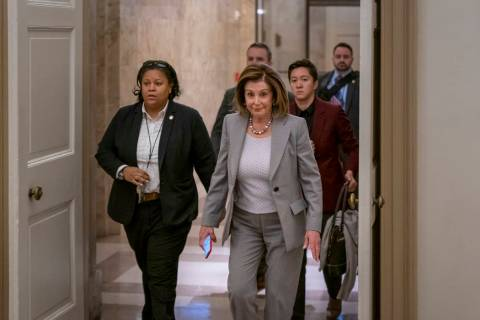 Speaker of the House Nancy Pelosi, D-Calif., arrives at the Capitol in Washington, Friday, Jan. ...
