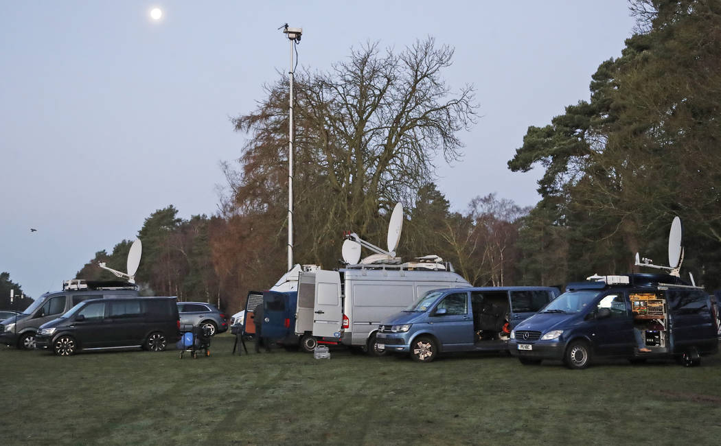 Media prepares in the early morning at the entrance of the castle in Sandringham, England, Mond ...
