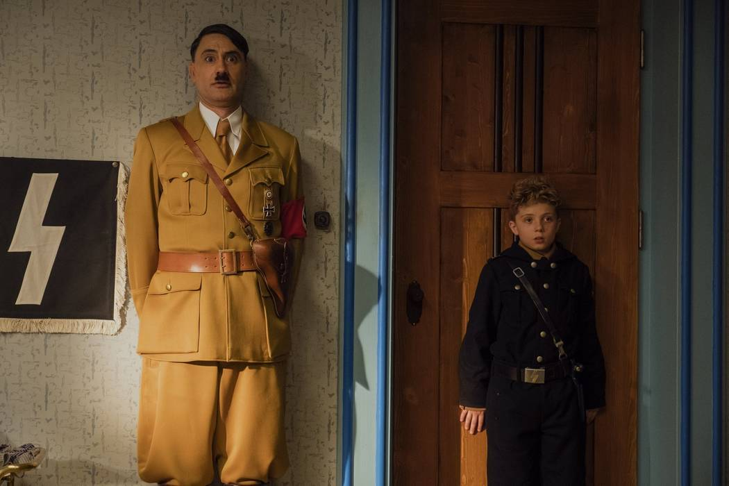 This image released by Fox Searchlight Pictures shows Taika Waititi, left, and Roman Griffin Da ...