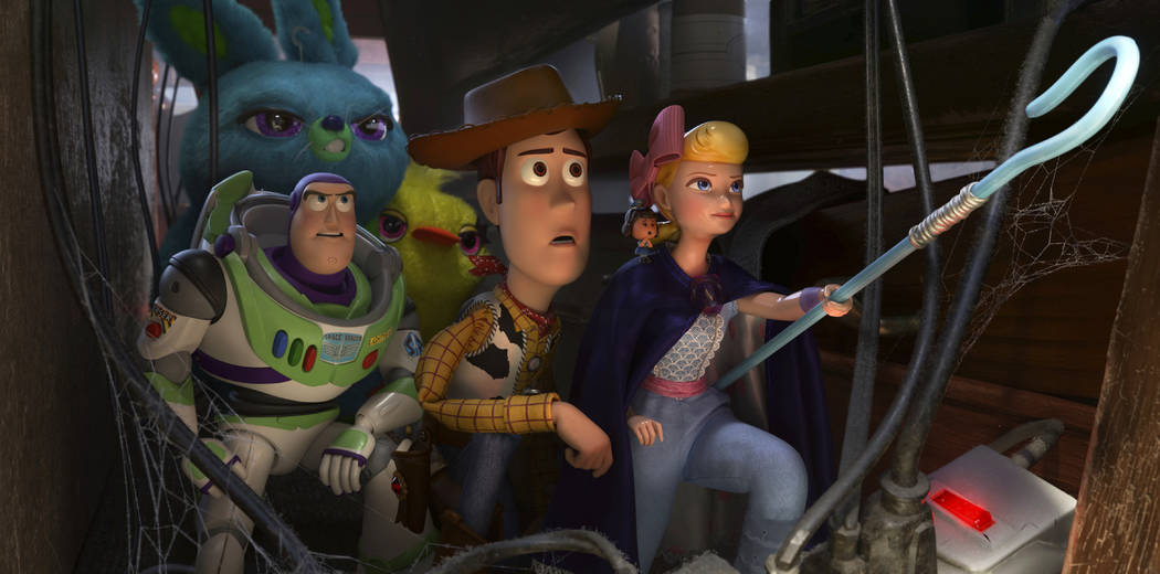 This image released by Disney shows, foreground from left, Buzz Lightyear, voiced by Tim Allen, ...