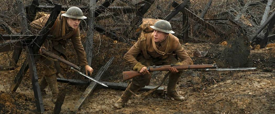 This image released by Universal Pictures shows Dean-Charles Chapman, left, and George MacKay i ...