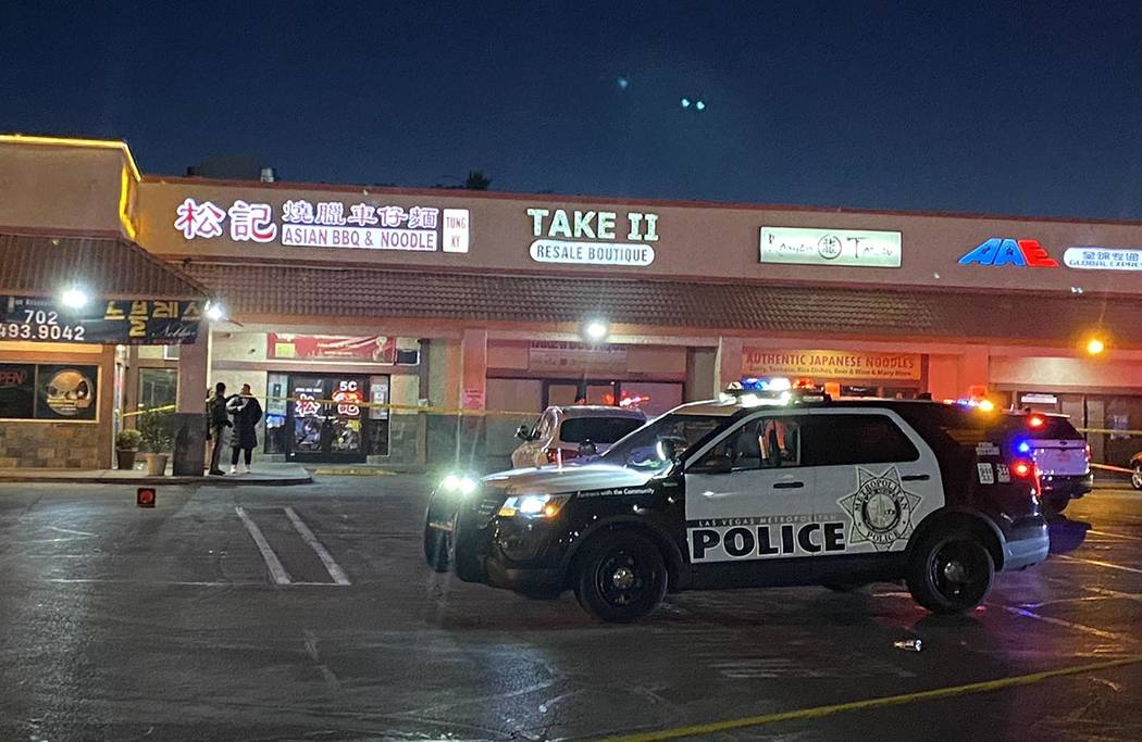 Las Vegas police investigate a shooting in front of a restaurant in the 3400 block of South Jon ...