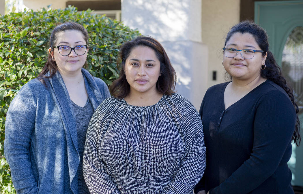 Sisters Mariela Amaro, left, Ruth Neall, center, and Andrea Lopez pose for a photograph outside ...